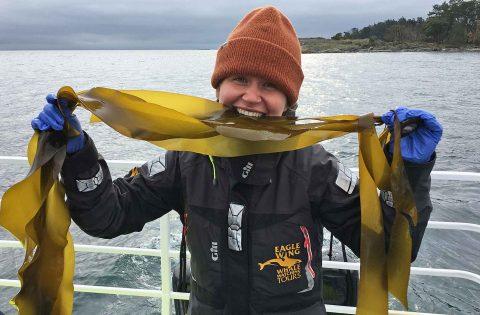our biologist Sydney eating some Bull Kelp